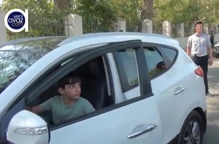 Reyd zamanı sükan arxasında azyaşlı uşağın olduğu avtomobil saxlanıldı - VİDEO