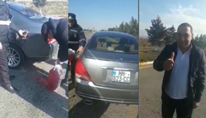 Azərbaycanda yol polisləri xarici vətəndaşa benzin aldı, üstəlik pul da verdi - VİDEO